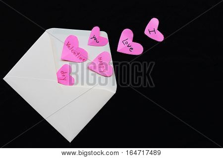 happy valentine day i love you words message in heart out of envelope on background black