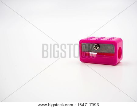Pink sharpener of pencil on white background