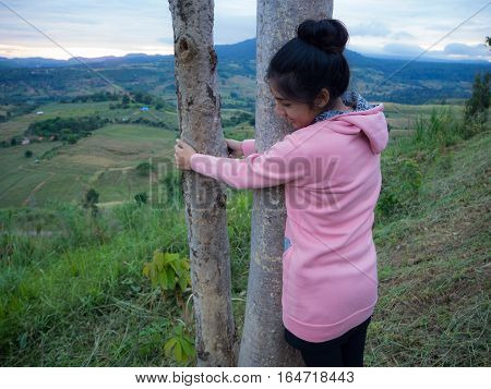 Asian woman hugging the tree landscape perfect sky background