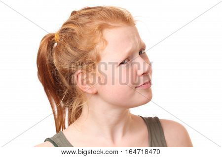Portrait of a doubtful teenage girl on white background