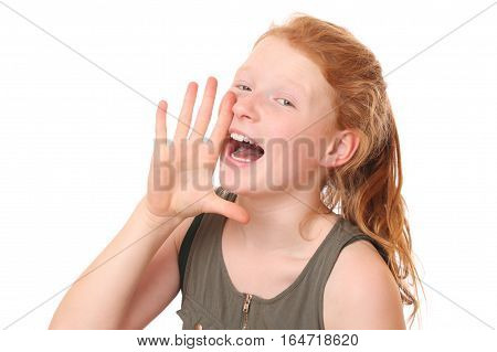 Portrait of a shouting teengae girl on white background