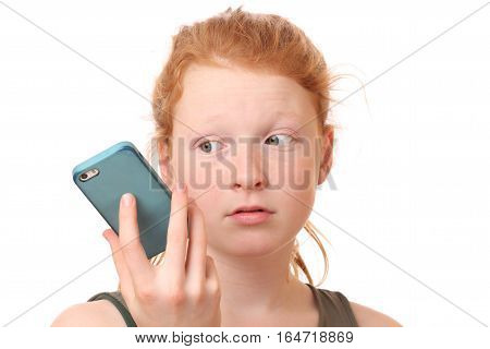 Portrait of a sad teenage girl holding mobile phone on white background