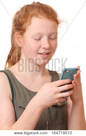 Portrait of a teenage girl with cellphone on white background