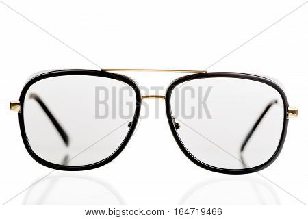 Black Sunglasses In A Retro Style On A White Background Isolated