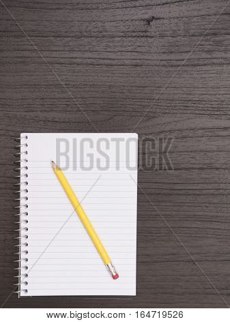 Desktop Surface With White Spiral Notebook Pencil Portrait