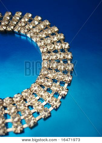 Close up of diamond necklace on blue background