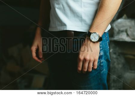 fashionable modern masculine look classic jeans and a white T-shirt