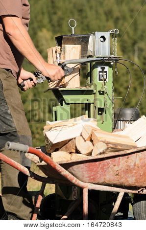 Man is using a electric log splitter