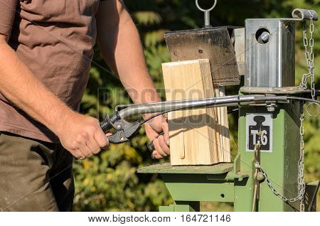 Man is using a electric log splitter poster
