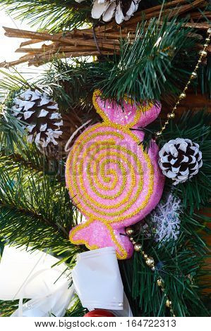 Large pink candy fir branches cones - festive decorations for the New Year Christmas. Decoration interior courtyard street. Close up