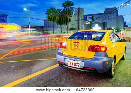 KEELUNG TAIWAN - NOVEMBER 28: This is a yellow taxi in Keelung city at night thes same Taxis are used in all Taiwanese cities on November 28 2016 in Keelung