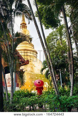 Woman Near Golden Temple In Thailand