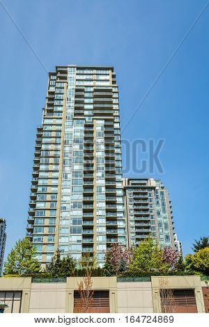 High rise residential building in Vancouver on blue sky background