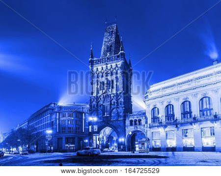 PRAGUE CZECH REPUBLIC - JANUARY 8 2017: Winter view of The Powder Tower and the Municipal House at the Republic Square in Prague. The Old Town is famous destination in Prague. Blue colored