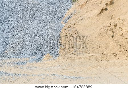 Closeup surface pile of sand and stone for construction work with ground textured background