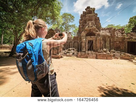 Tourist Photographing The Gopura Of Temple In Angkor, Cambodia