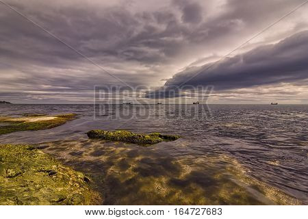 Exciting long exposure day seascape with stormy clouds