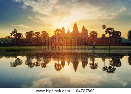 Mysterious Towers Of Ancient Angkor Wat In Cambodia At Sunrise