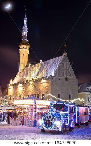 Christmas market and christmas train near city hall in old city of Tallinn Estonia