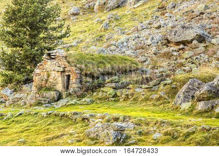 Remote high altitude stone shelter located in Pyrenees Mountains.