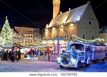Christmas train near christmas market in old city of Tallinn Estonia