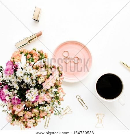 Wildflowers bouquet coffee cup golden pen clips and accessories. Styled flat lay mockup