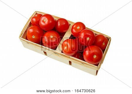Ripe tomatoes in a wicker basket isolated on white background. Top view.