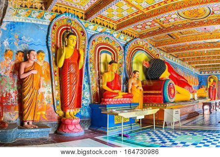 ANURADHAPURA SRI LANKA - NOVEMBER 26 2016: The statue of Standing Buddha offering protection Seated Buddha - meditating and Reclining Buddha statue - the pose of Nirvana Isurumuniya Rock Temple on November 11 in Anuradhapura.
