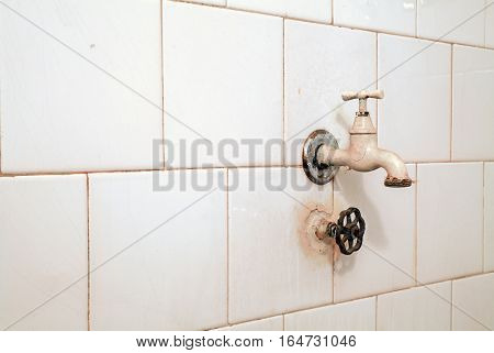 Old Faucet And Tiles