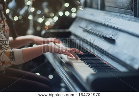 Her hands on the keyboard piano vintage