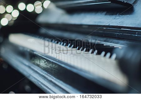 Old vintage piano keyboard. The beautiful background blur