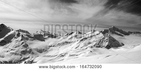 Black And White Panorama Of Caucasus Mountains In Snow Winter Evening