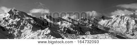 Black And White Panoramic View On Snowy Mountains In Sunny Day