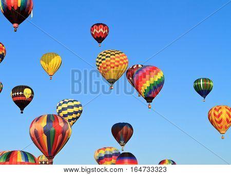 Hot Air Balloon Flying Against The Blue Sky