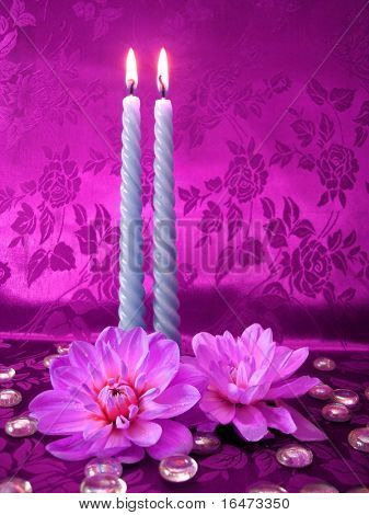 celebration table (two candles and flowers on pink background)