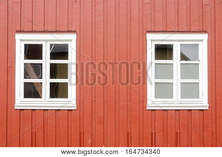 Red wall and white windows of a traditional wooden rorbu in the Lofoten Islands Norway Europe