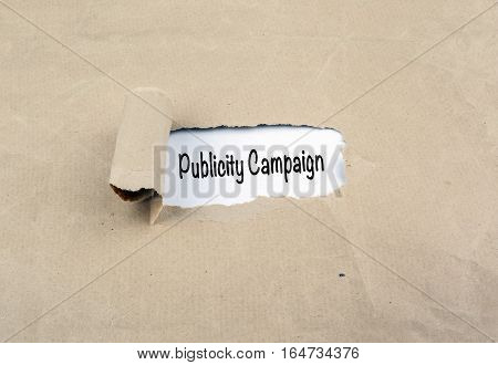 Publicity Campaign. Torn, yellow, old paper background.