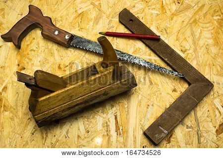 carpenter tools on wooden surface, occupation  concept