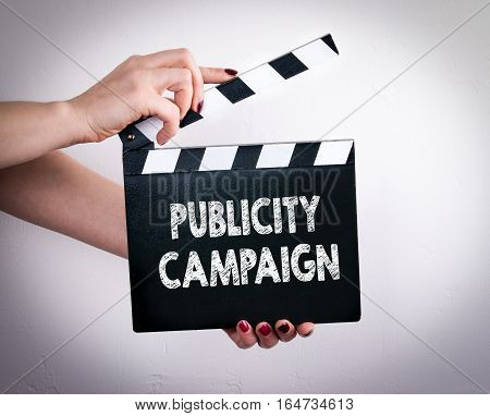 Publicity Campaign. Female hands holding movie clapper.