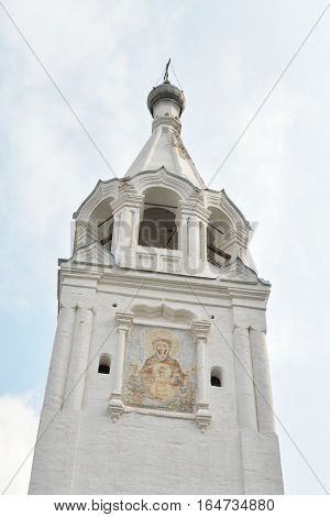 Bell tower in Saviour Priluki Monastery at cloud day near Vologda Russia.