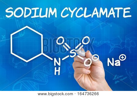 Hand With Pen Drawing The Chemical Formula Of Sodium Cyclamate