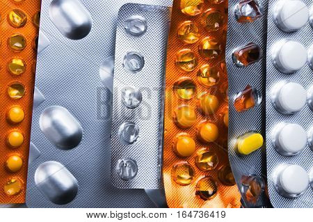 Assorted packets or blisters of various pills and medication. Medical overdose or addiction abstract concept.