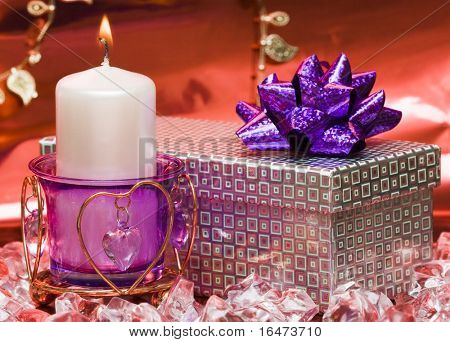violet candle with heart and gift box