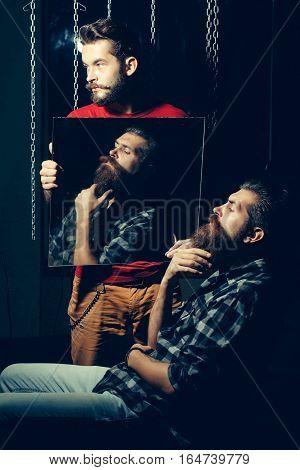 Man Holds Mirror Reflecting Customer