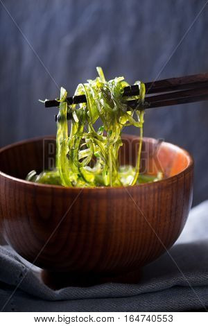 Chinese chopsticks with chuka salad vertical background, vertical, napkin