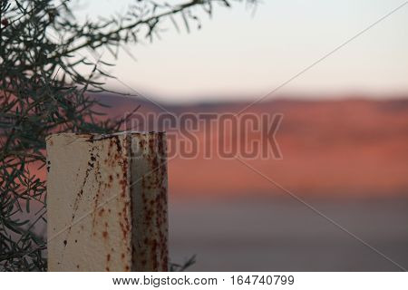 post at the australian outback with red rocks
