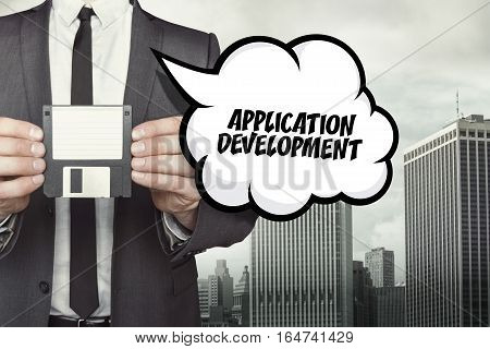 Application Development text on speech bubble with businessman holding diskette