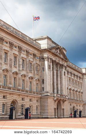 LONDON, UK - JULY 11, 2012: A front view of Buckingham Palace in London, England, on a cloudy summer day.