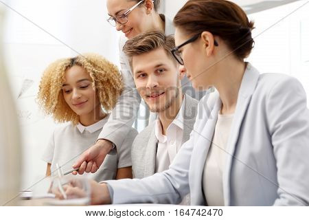 Corporate business meeting. Office work. Business consultants while working in a team. The team of employees at work.