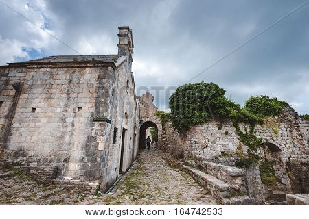Ancient stone ruins and serbian church on Old Bar town, Montenegro. Stari Bar - ruined medieval city on Adriatic coast, Unesco World Heritage Site.